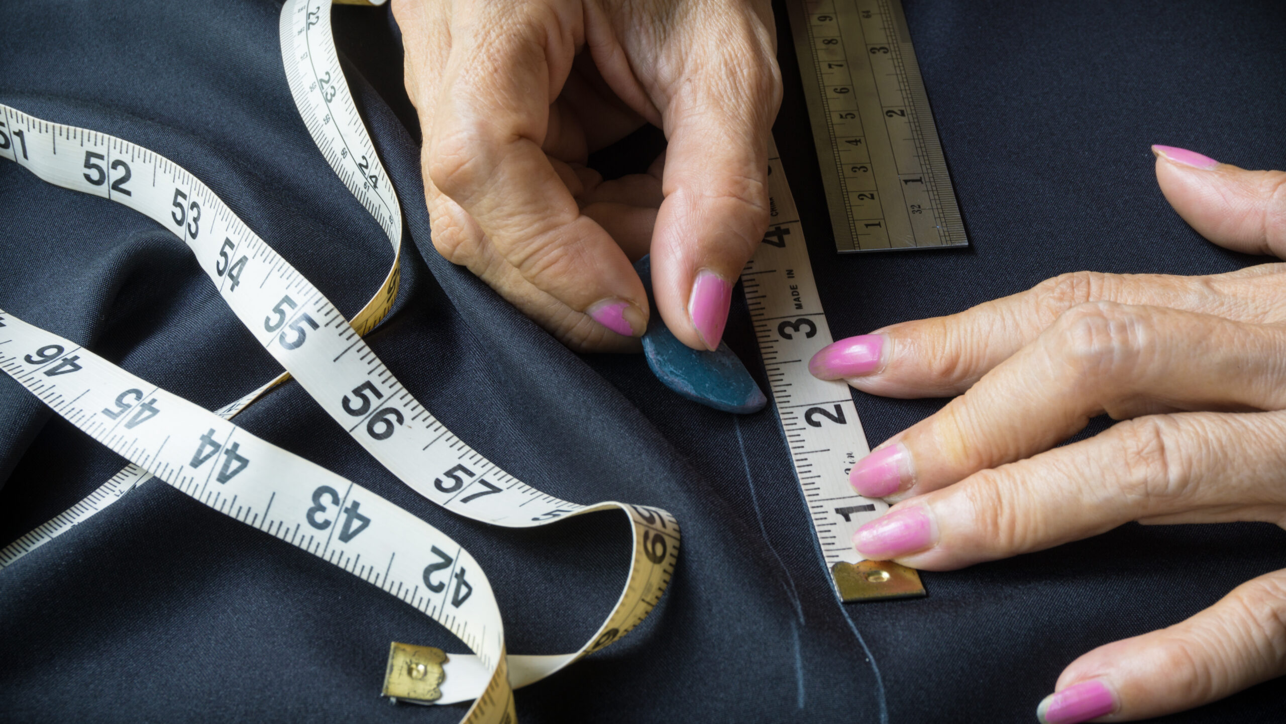 Sewing,Chalk,Marking,On,Black,Fabric,And,Measuring,Tape
