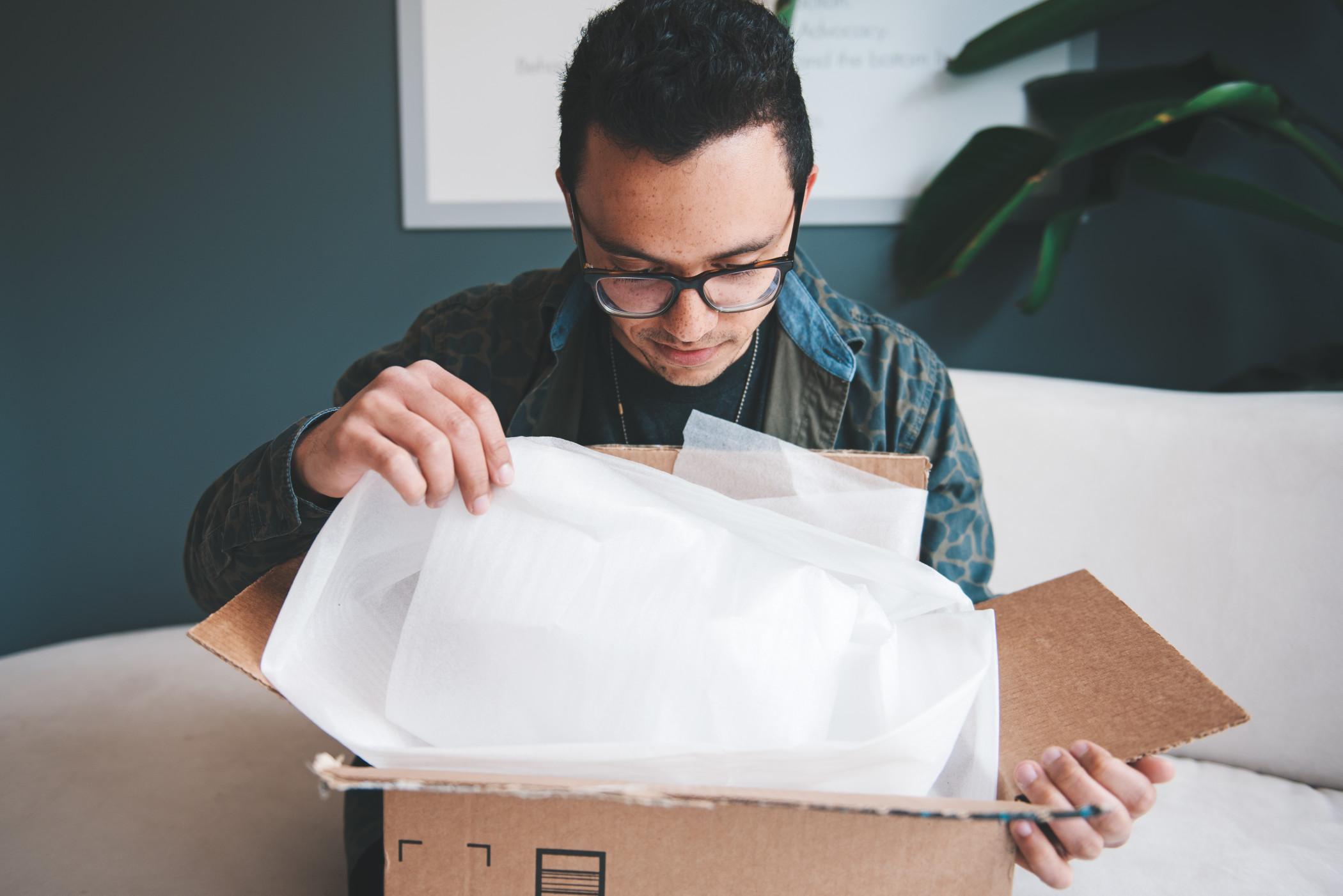 guy-opening-gift-package_t20_lWJEeB